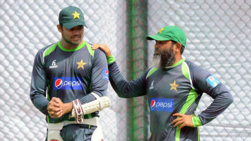 Bowling coach Mushtaq Ahmed chats with ODI captain Azhar Ali at a training session