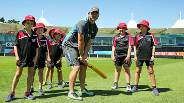Corey Anderson teaches kids batting at an ICC coaching clinic at Hagley Oval