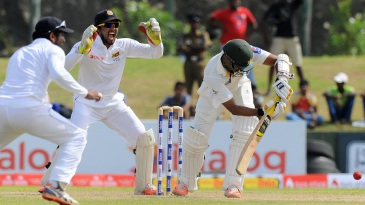 Azhar Ali is trapped in front by Rangana Herath