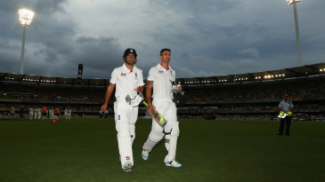 Kevin Pietersen and Alastair Cook walk off the field at close of play