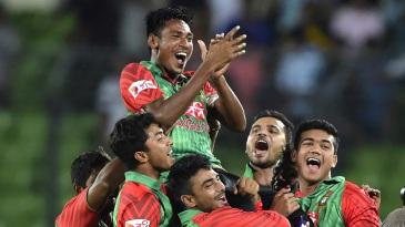 The new hero: Mustafizur Rahman is hoisted by his team-mates