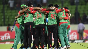 The Bangladesh players get together after a historic series win