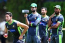 Ehsan Adil's team-mates watch him run into bowl during Pakistan's practice, Colombo, June 23, 2015