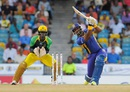 Dwayne Smith launches one down the ground, Barbados Tridents v Jamaica Tallawahs, Bridgetown, June 23, 2015