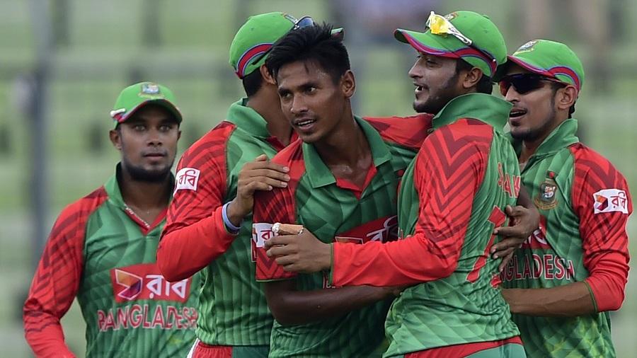 Team-mates mob Mustafizur Rahman after he removed Rohit Sharma