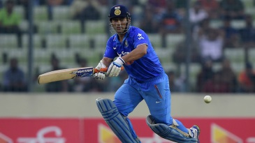 MS Dhoni works the ball through the leg side