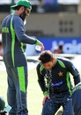 Mushtaq Ahmed helps Yasir Shah cool down at Pakistan's training, Colombo, June 24, 2015