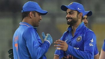 MS Dhoni and Virat Kohli share a laugh after India's win over Bangladesh