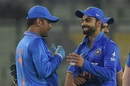 MS Dhoni and Virat Kohli share a laugh after India's win over Bangladesh, Bangladesh v India, 3rd ODI, Mirpur, June 24, 2015