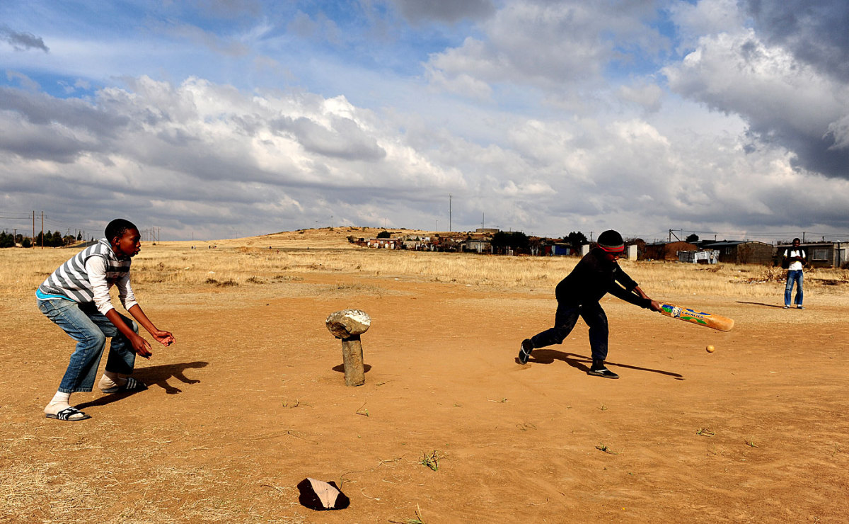Kids play cricket at the black settlement of Botshabelo near Bloemfontein