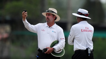 Umpire Richard Illingworth examines the light meter reading