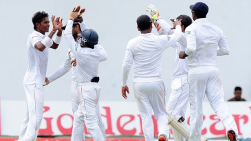 Dushmantha Chameera is congratulated on the wicket of Asad Shafiq
