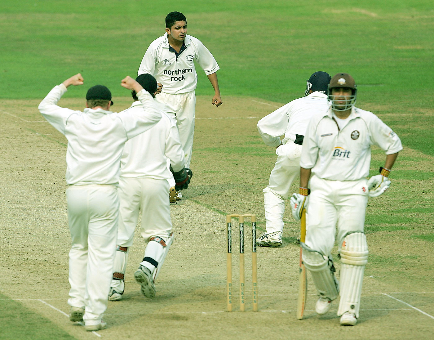 Yogesh Golwalkar, seen here taking a wicket for Middlesex in 2005, was picked by Kings XI on the strength of videos he made of himself bowling