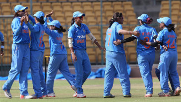 Indian players celebrate their 17-run win
