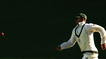 Matthew Hayden chases after a ball