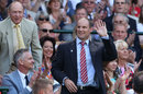 Andrew Strauss waves to the crowd at Wimbledon as Geoffrey Boycott looks on, July 4, 2015