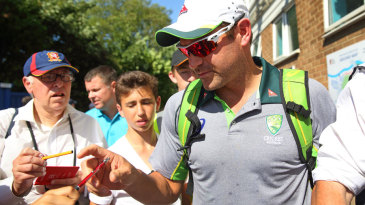 Ryan Harris signs autographs after announcing his retirement