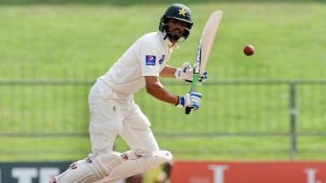 Shan Masood works the ball through the leg side