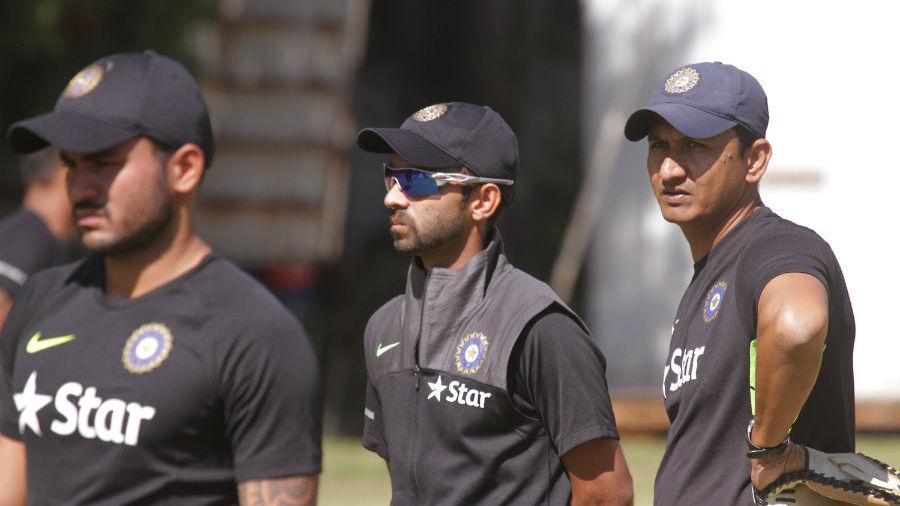 Manish Pandey and Ajinkya Rahane with assistant coach Sanjay Bangar at a training session
