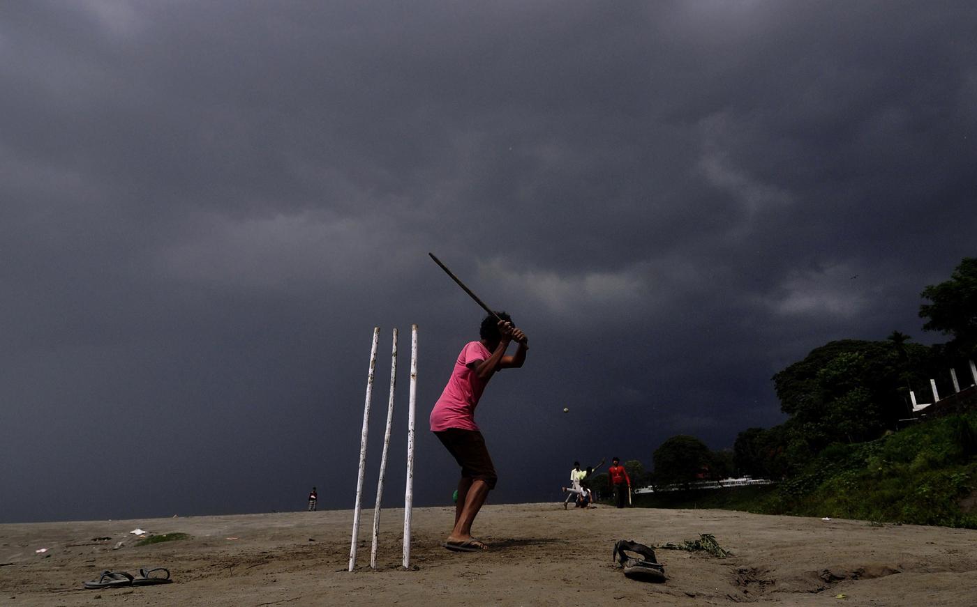 Children in Guwahati play cricket