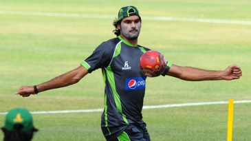 Mohammad Irfan plays football during Pakistan's practice