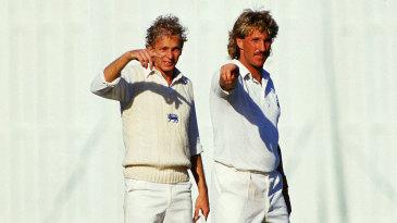 Ian Botham and David Gower set the field