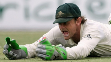 Adam Gilchrist completes the catch to remove MS Dhoni