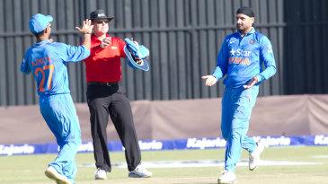 Harbhajan Singh and Ajinkya Rahane celebrate a wicket