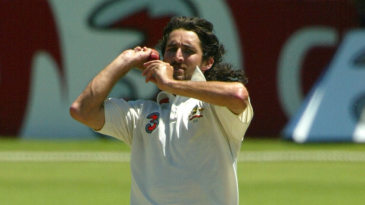Jason Gillespie in his delivery stride