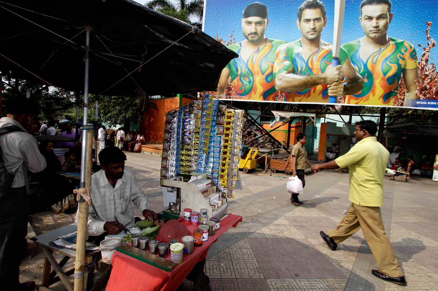 A hoarding featuring India's cricketers overlooks a Kolkata street