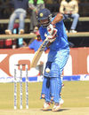 Kedar Jadhav gets up his toes to defend one, Zimbabwe v India, 2nd ODI, Harare, July 12 2015