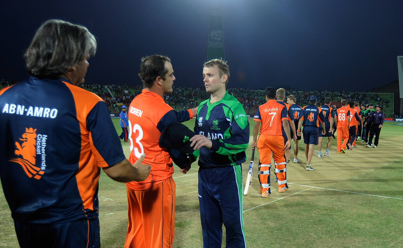 Borren to lead by example: the Netherlands captain with his counterpart, Porterfield, after the game