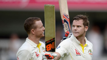 Chris Rogers and Steven Smith take in the applause as they leave the field unbeaten