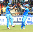 Sanju Samson and Kedar Jadhav celebrate a wicket, Zimbabwe v India, 2nd T20I, Harare, July 19, 2015
