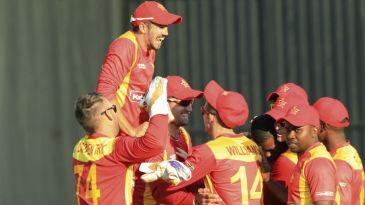 Graeme Creamer and his team-mates celebrate a wicket