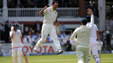 Mitchell Johnson leaps in triumph after removing Alastair Cook