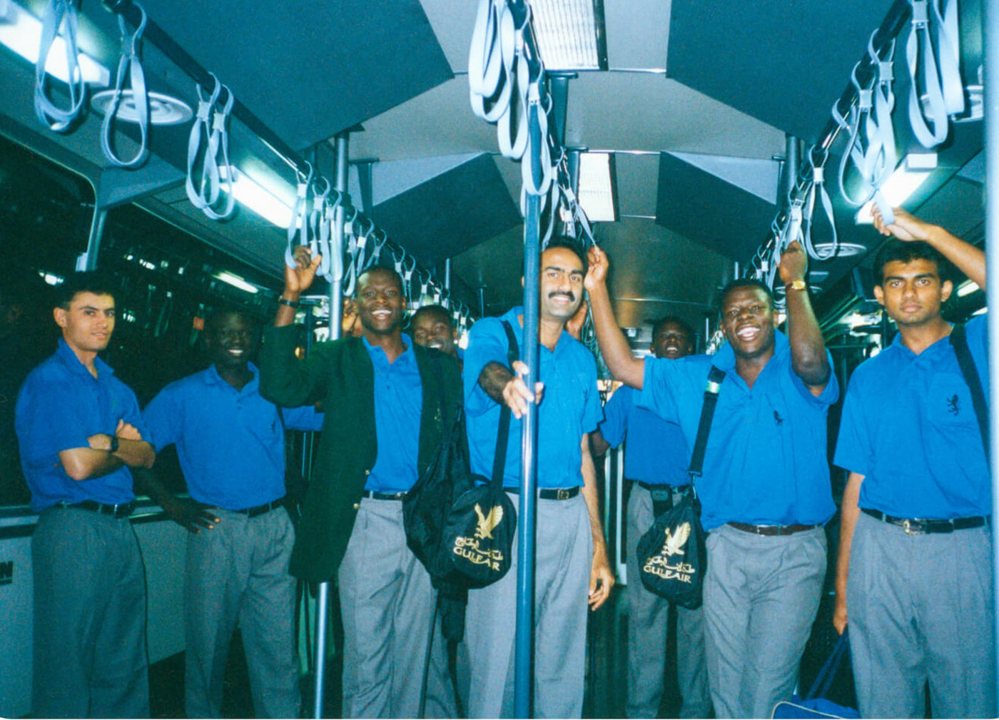The Kenyans on board an airport terminal bus in 1995. Karim is in the centre