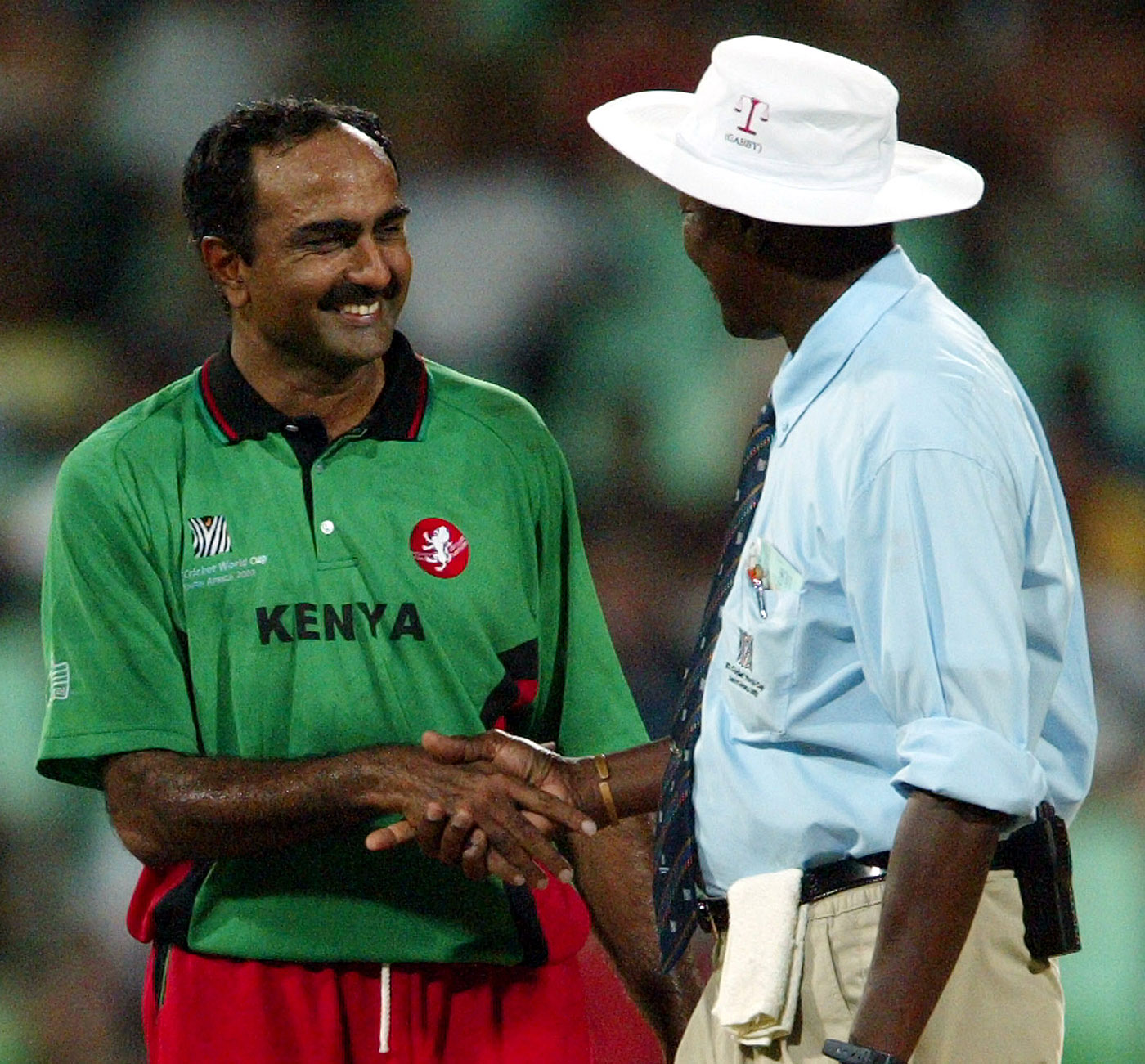 The umpire who turned fan: Steve Bucknor shakes Aasif Karim's hand during the match against Australia in Durban, 2003