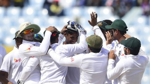 Mustafizur Rahman is mobbed by his team-mates after he removed JP Duminy, Bangladesh v South Africa, 1st Test, Chittagong, 1st day, July 21, 2015