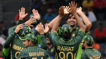 Mohammad Irfan celebrates with his team-mates after dismissing Kusal Perera
