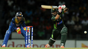 Ahmed Shehzad drives down the ground