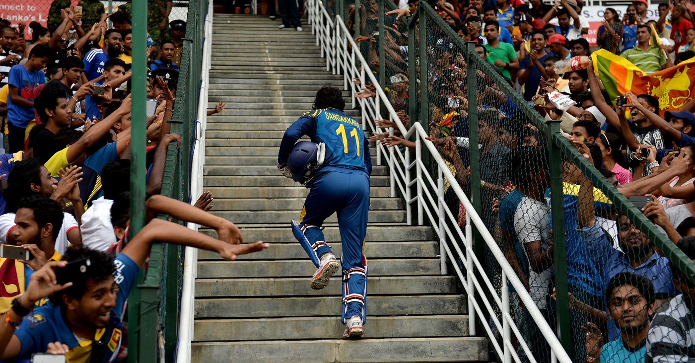 Kumar Sangakkara heads for the dressing room