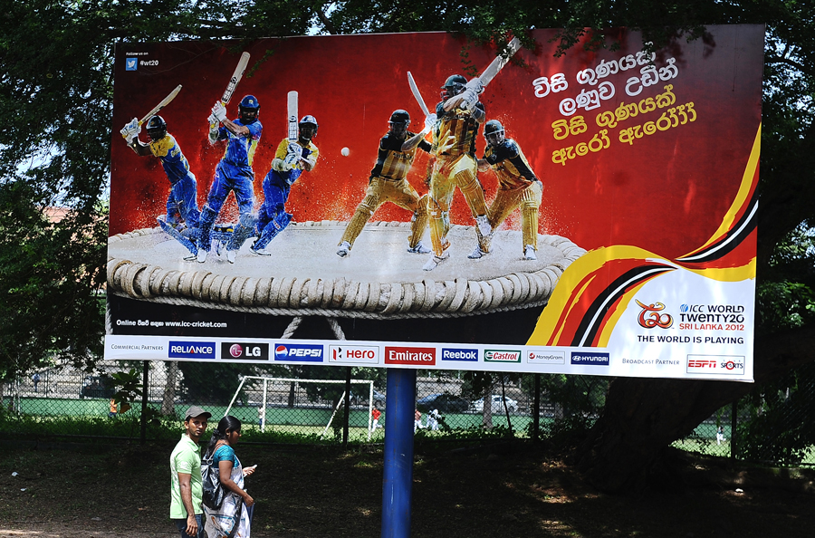 Advertiser's choice: three Sangakkaras on one hoarding