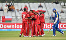 Ajay Lalcheta is mobbed by his team-mates after dismissing Gerrie Snyman, Namibia v Oman, World T20 Qualifier, Play-off, Dublin, July 23, 2015
