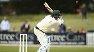 Michael Clarke reaches for a delivery