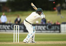 Michael Clarke reaches for a delivery, Derbyshire v Australians, Tour match, Derby, 1st day, July 23, 2015