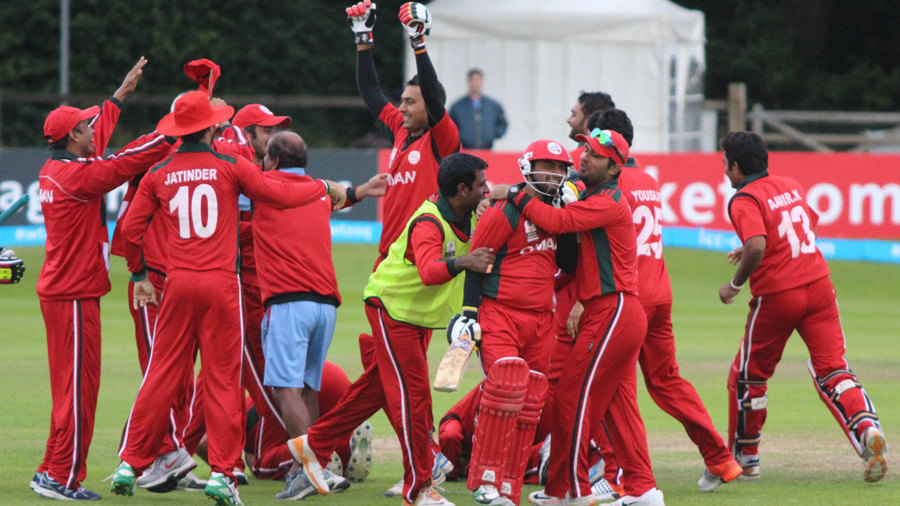 Zeeshan Siddiqui is mobbed by elated team-mates
