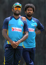 Seekkuge Prasanna and Lasith Malinga look on during a training session, Hambantota, July 25, 2015
