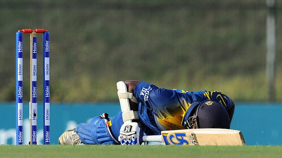 Kusal Perera lost his balance while trying to block a yorker