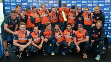 The Netherlands players celebrate after sharing the trophy with Scotland